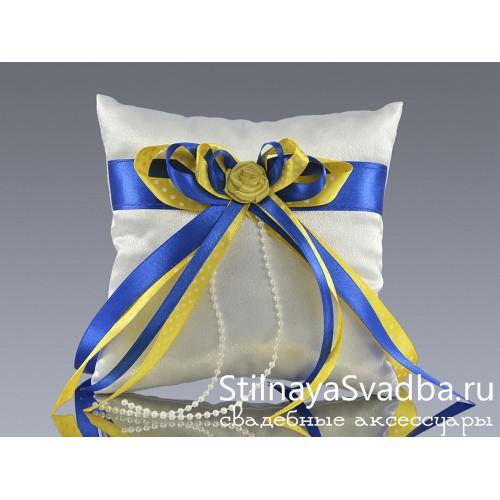 Подушечка с сине-жёлтым бантом фото