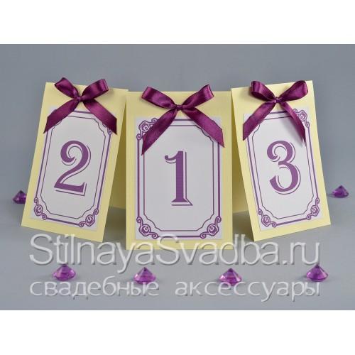 Номерки для столиков с пурпурным бантом  фото