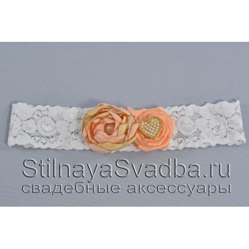 Подвязка в персиково-пудровом цвете фото